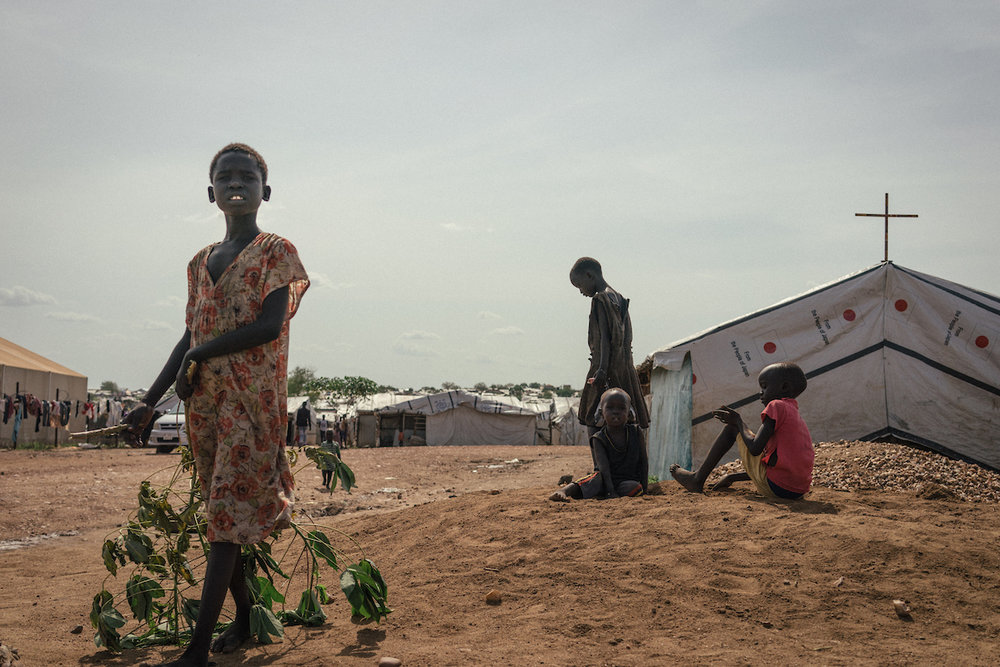 Girls are seen outside a makeshift church in a camp in South Sudan.
