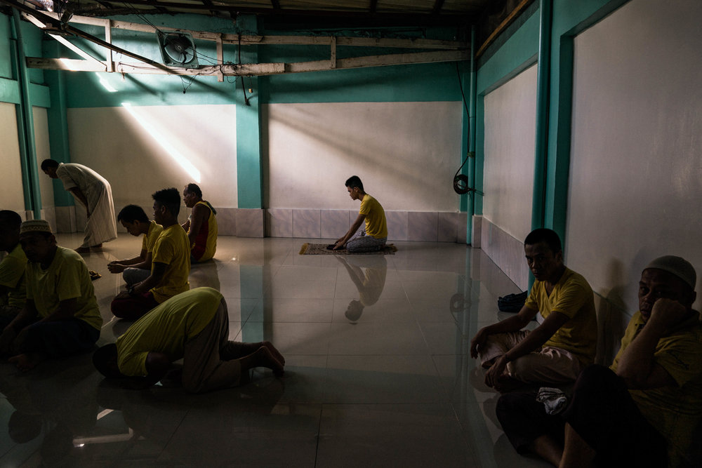Men are seen saying their prayers inside a mosque in the Manila City Jail in Manila, Philippines on October 31, 2018. In the Philippines, men with pending cases spend months, sometimes years, in overcrowded cells waiting to be charged, sentenced, or tried.