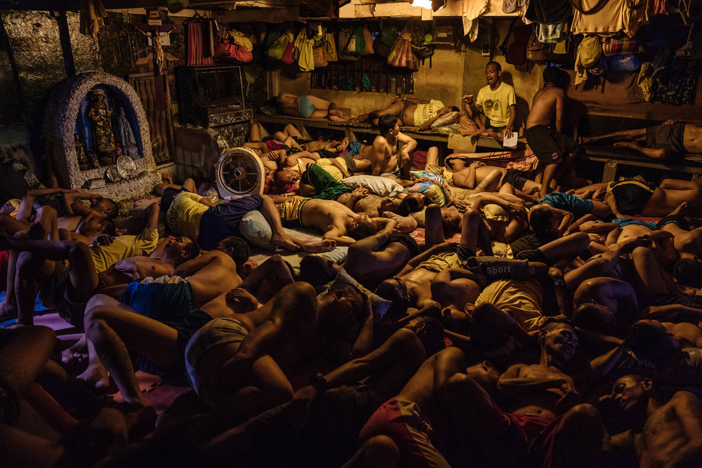 Detainees are seen sleeping by a small grotto of Mary in the Manila City Jail in Manila, Philippines on October 31, 2018. In the Philippines, men with pending cases spend months, sometimes years, in overcrowded cells waiting to be charged, sentenced, or tried.