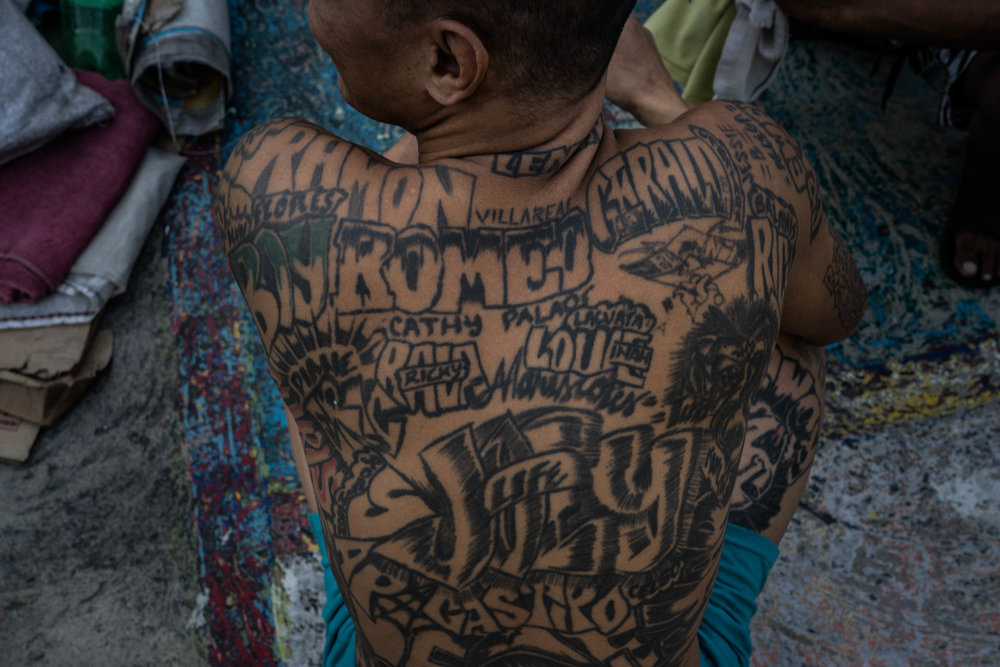 A man's back tattoo is seen during a surprise operation in search for contrabands inside the Manila City Jail in Manila, Philippines on November 1, 2018. In the Philippines, men with pending cases spend months, sometimes years, in overcrowded cells waiting to be charged, sentenced, or tried.