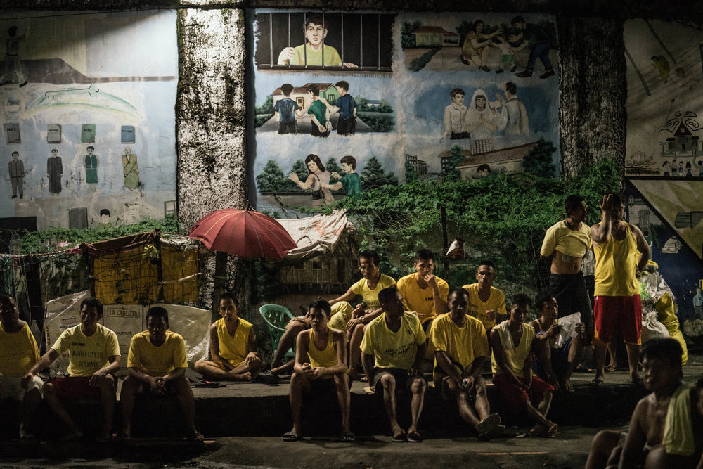 Men are seen hanging out in the evening in the Manila City Jail in Manila, Philippines on October 31, 2018. In the Philippines, men with pending cases spend months, sometimes years, in overcrowded cells waiting to be charged, sentenced, or tried.