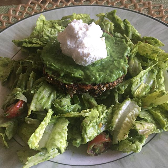 Trying out some vegan recipes inspired by a visit to LA's Cafe Gratitiude. Vegetable burger with almond cream over a salad with avacado spinach cream dressing. Tastes fresh and flavorful and just right for the anticipation of spring!  #cafegeatitude #cafegratitudelarchmont #veganforlunch #tryingveganrecipes #easyveganrecipes #spring2017trends #eastcoastvegan