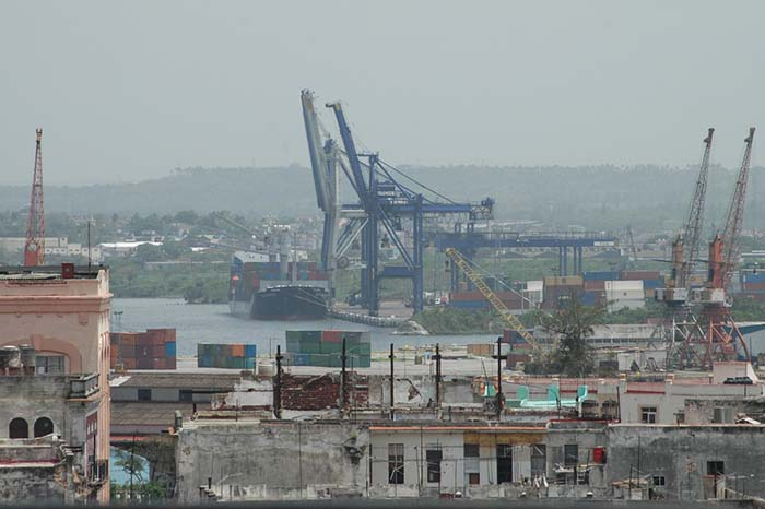 It could be some time before Cuban container cranes, such as these pictured in Havana, start lifting more volumes bound for international markets.