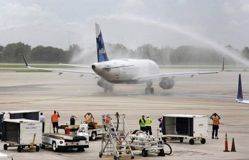 The JetBlue flight from Fort Lauderdale gets a water-cannon salute as it arrives in Santa Clara, Cuba, last week. Carl Juste / Miami Herald