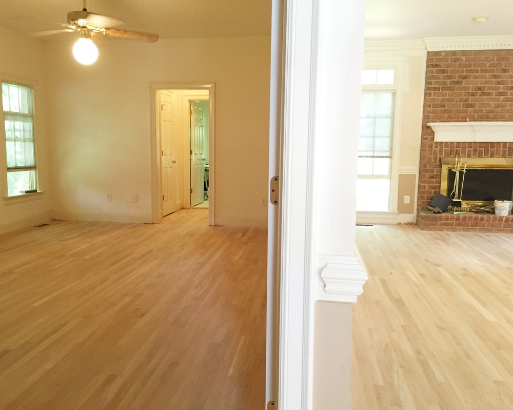 The downstairs looks completely different with the addition of hardwood floors!