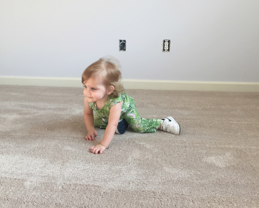 CL checking out the new carpet in her room.