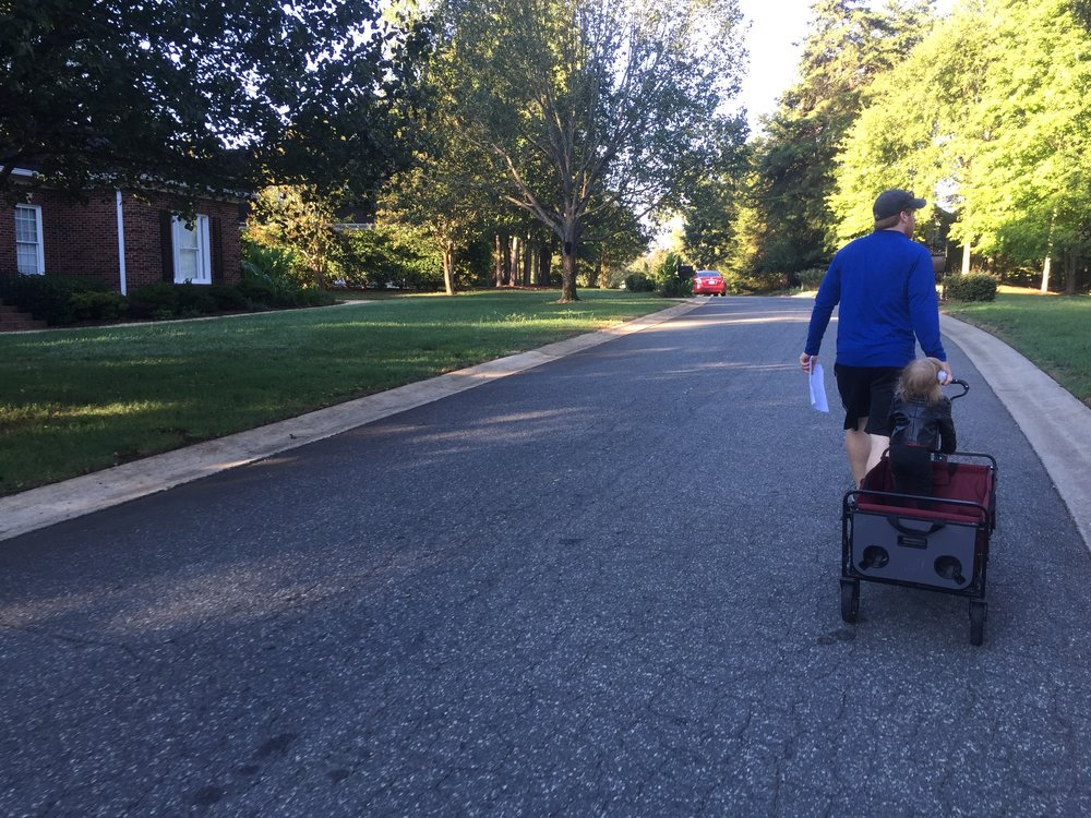 Pulling Ms. Daisy in the wagon.