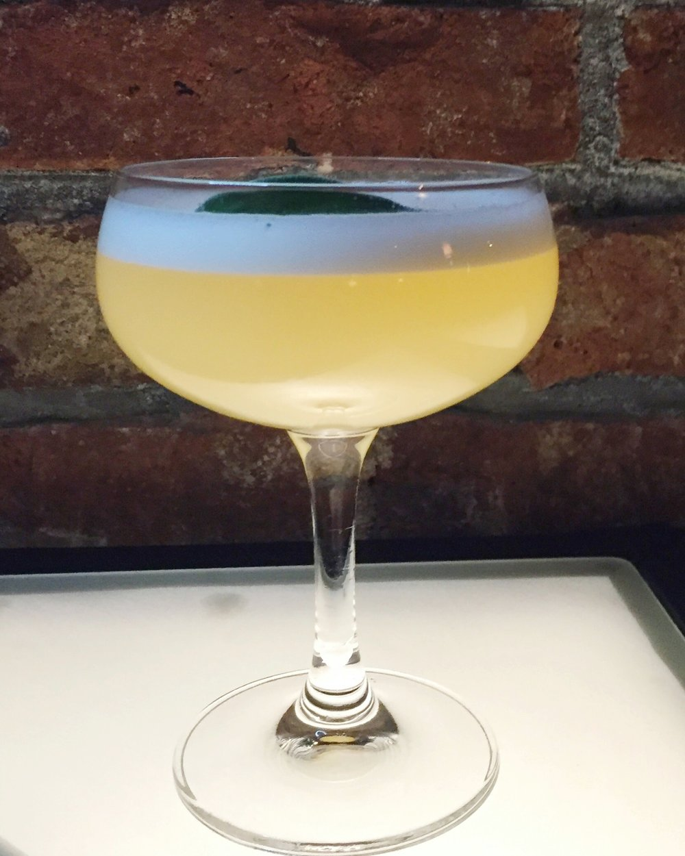 Great King Street Glasgow Scotch Whiskey Blend, Lemon Juice, Cyril Zangs Eau de Vie de Cidre, The King's Ginger, Egg White, Honey, Sage.