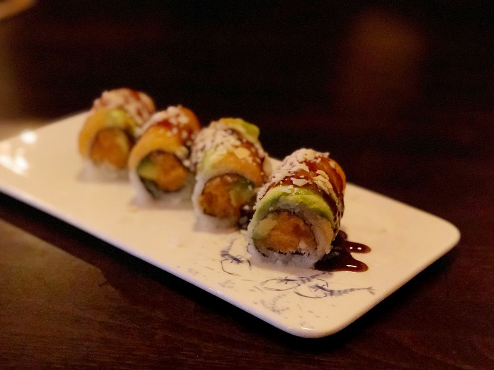 Samurai Roll | Spicy salmon, crunch, mango with salmon, avocado, coconut chips on top