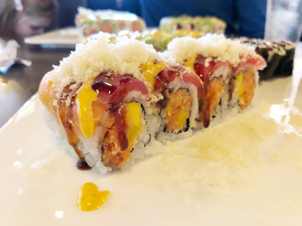 Tiger Roll - Spicy tuna crunch and mango in the outside, tuna and salmon on the outside, topped with crunch and masago.