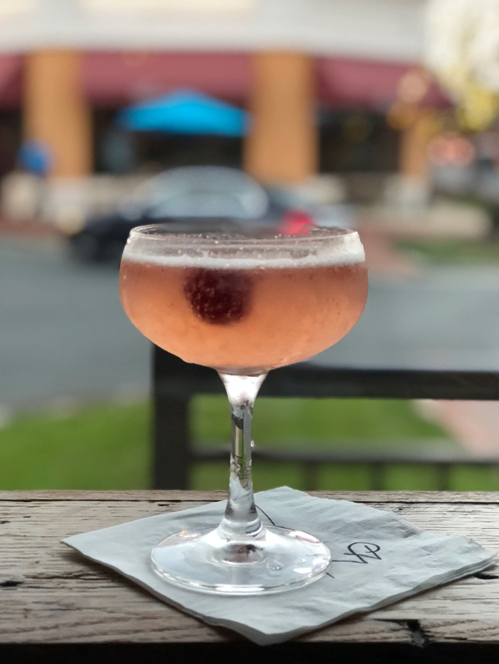 Calling Dr. Love | A mildly tart and refreshing mix of fresh raspberries, Ban Vodka, St. Germaine and prosecco.
