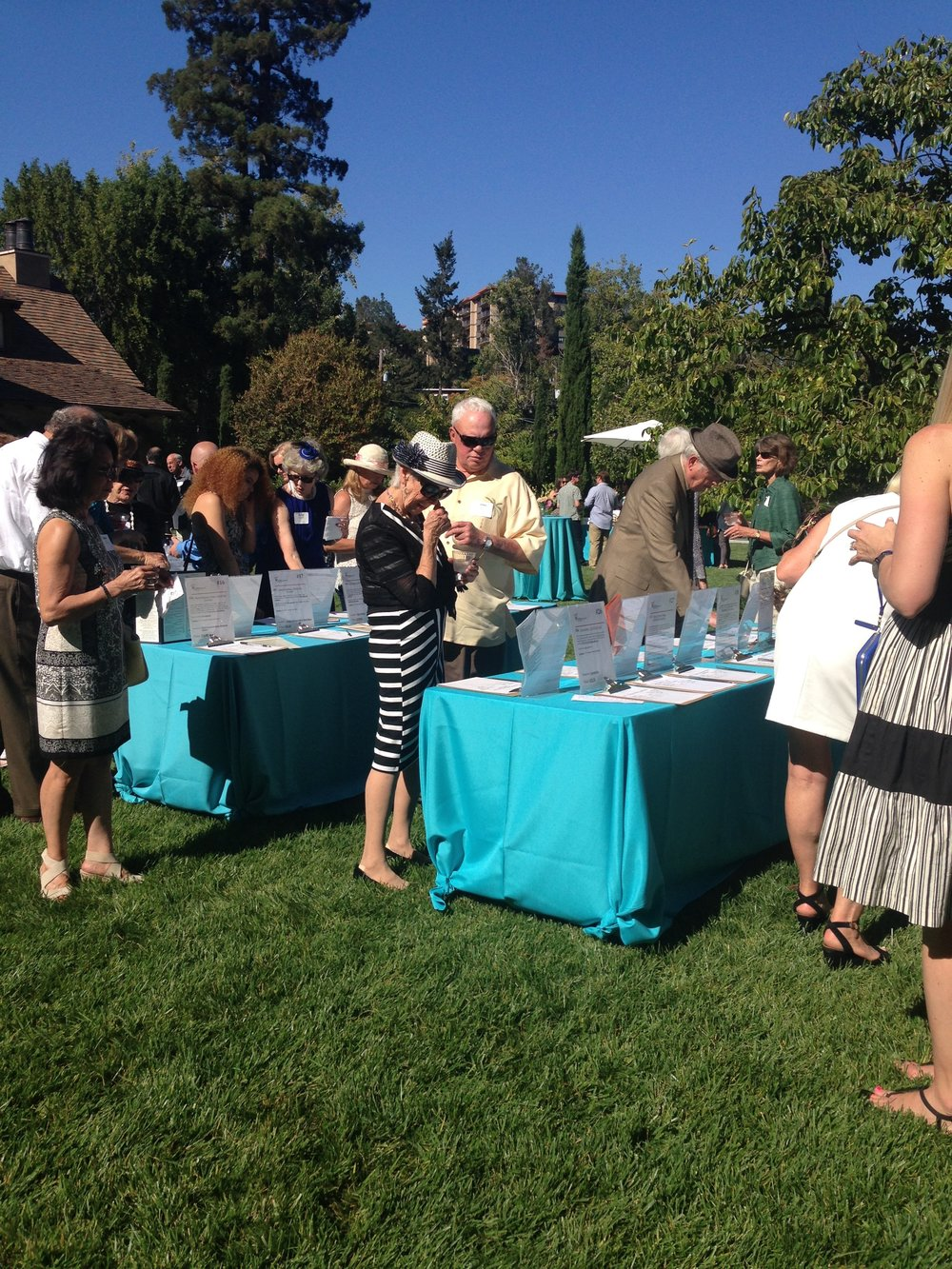 It didn't take long for the Silent Auction tables to be the most popular area to be at the Garden Party!