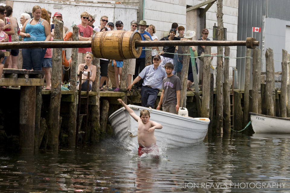 Grand Mananers celebrate Canada Day by greasing up a pole and riding a barrel to the end of it to capture a flag. Whether you grab the flag or not, you still plunge into the water, which can be very cold even in summer.