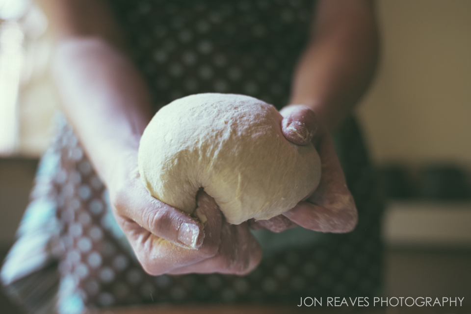 My wife kneading dough in natural window light.