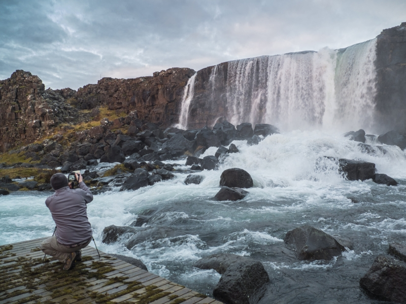 Me photographing a waterfall in Thingvellir National Park Iceland, 2016 (Photo by my wife, Alison)