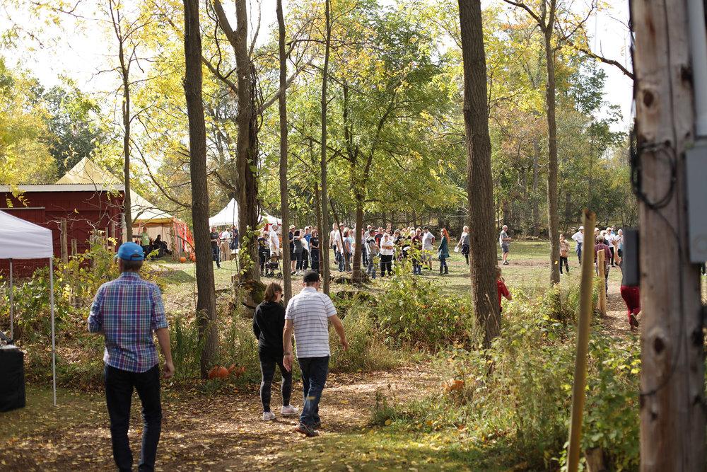 People_walking_to_tent.JPG