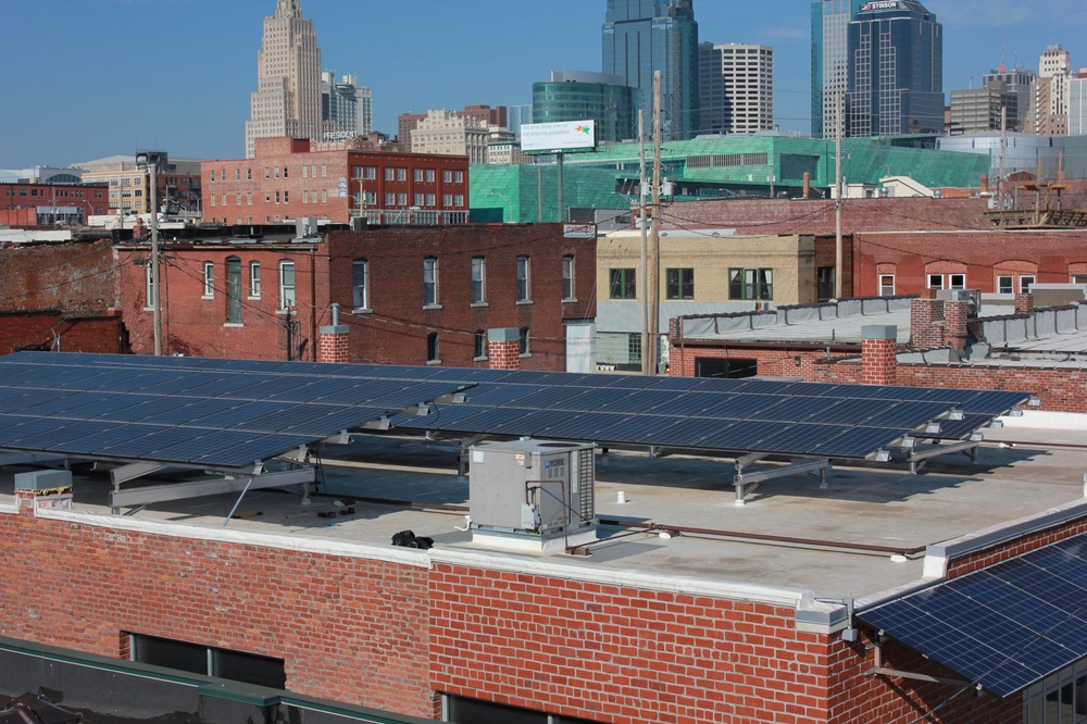 Solar array in Kansas City's Crossroads district. An historic building with structural challenges, Cromwell provided a custom solution including a solar awning and a uniquely engineered roof mounting system connecting into the steel of the building.