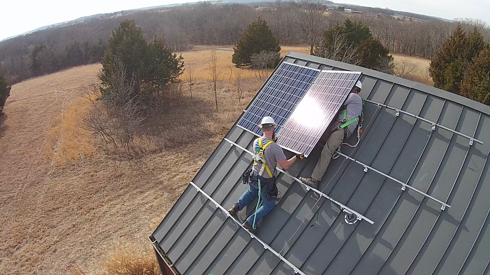 Cromwell Solar crew installing a panel © 2015 Cromwell Environmental