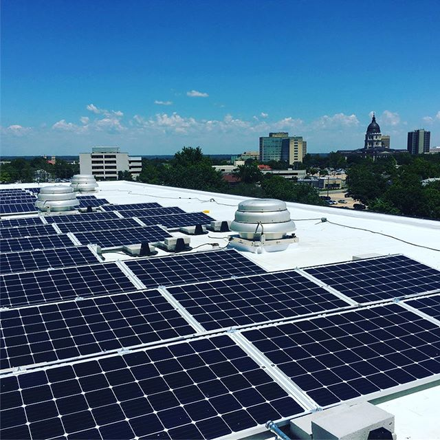 Our crews just completed this 25 kW project atop a 9-story building near downtown #topeka! #kssolar