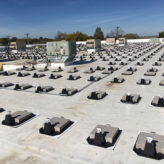 Our crews continue to make progress on @themerccoop project. The ballast pans and bricks are all set and the rows are getting straightened out, the inverters are in place, and conduit runs are being completed. Soon they will pull wire and start laying glass (panels) and this roof will really look like a solar project! #kssolar #kansassolar