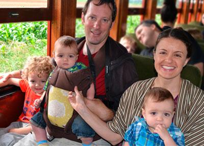 The Bryan family riding Thomas the Train.