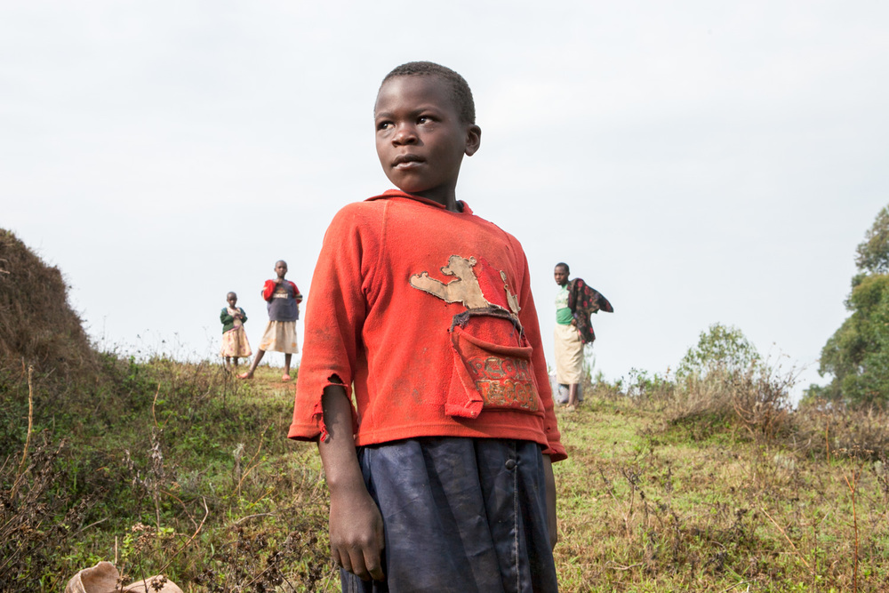Several young boys stop on a hillside near Lake Bunyonyi in Uganda.