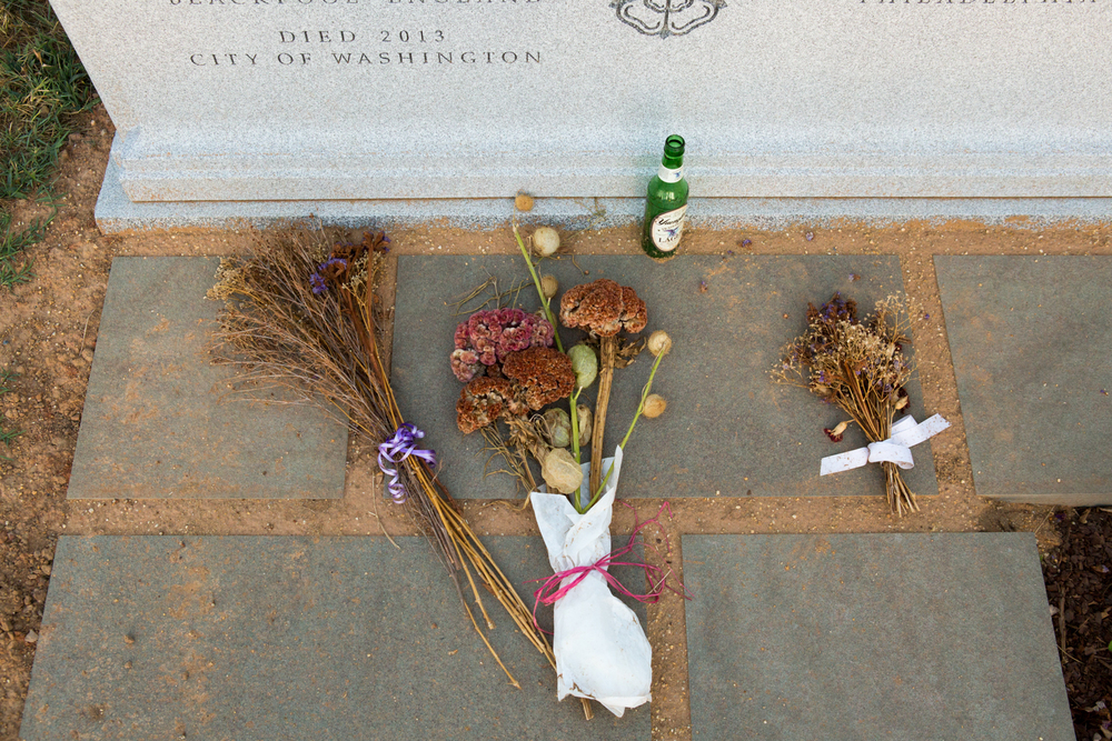 Flowers and a beer bottle adorn a gravesite at the Congressional Cemetery in Washington, D.C.
