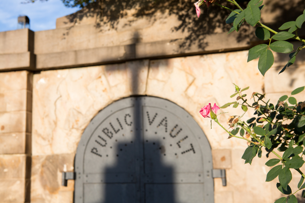 A flower and a shadow of a cross are visible at the Public Vault in the Congressional Cemetery in Washington, D.C.