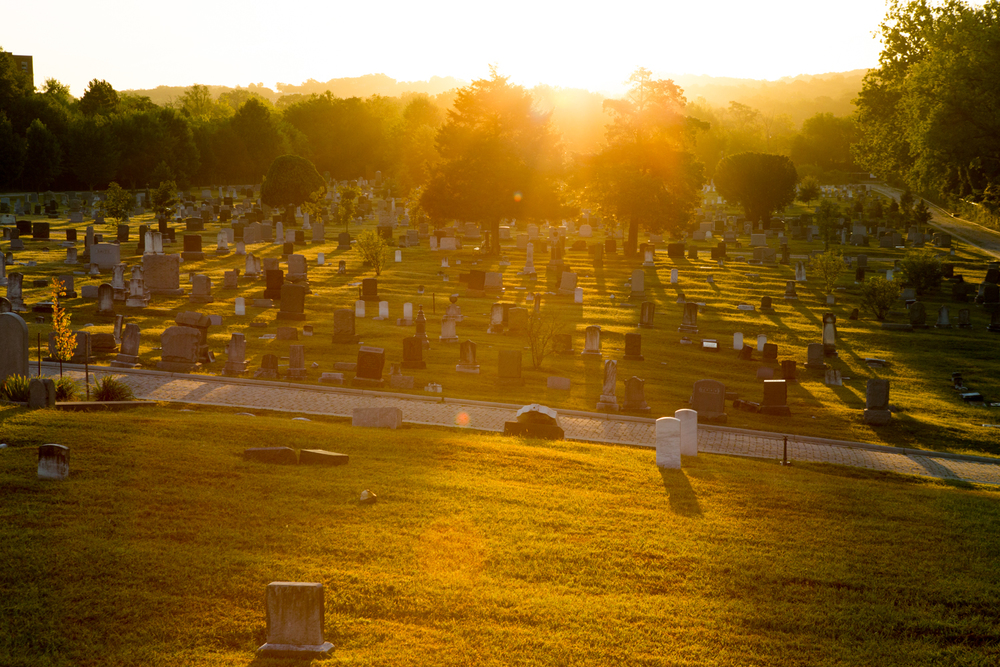 The sun rises over the eastern-most section (near Prout and Henderson Streets) of the Congressional Cemetery in Washington, D.C.