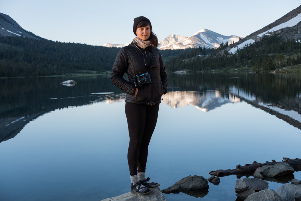 A portrait of photographer Morgan Levy at Tioga Lake.