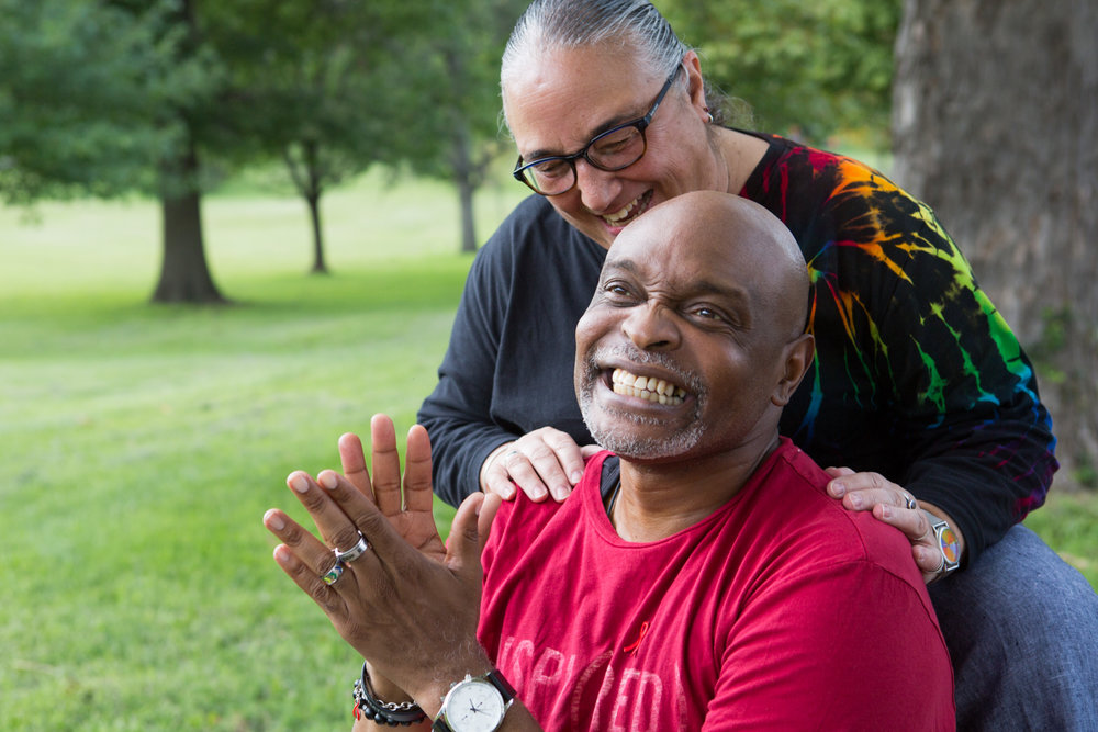 Carlton Smith (front) poses for a portrait with Monte Ephraim at Druid Hill Park in Baltimore, Maryland during a National Faith HIV & AIDS Awareness Day Walk.