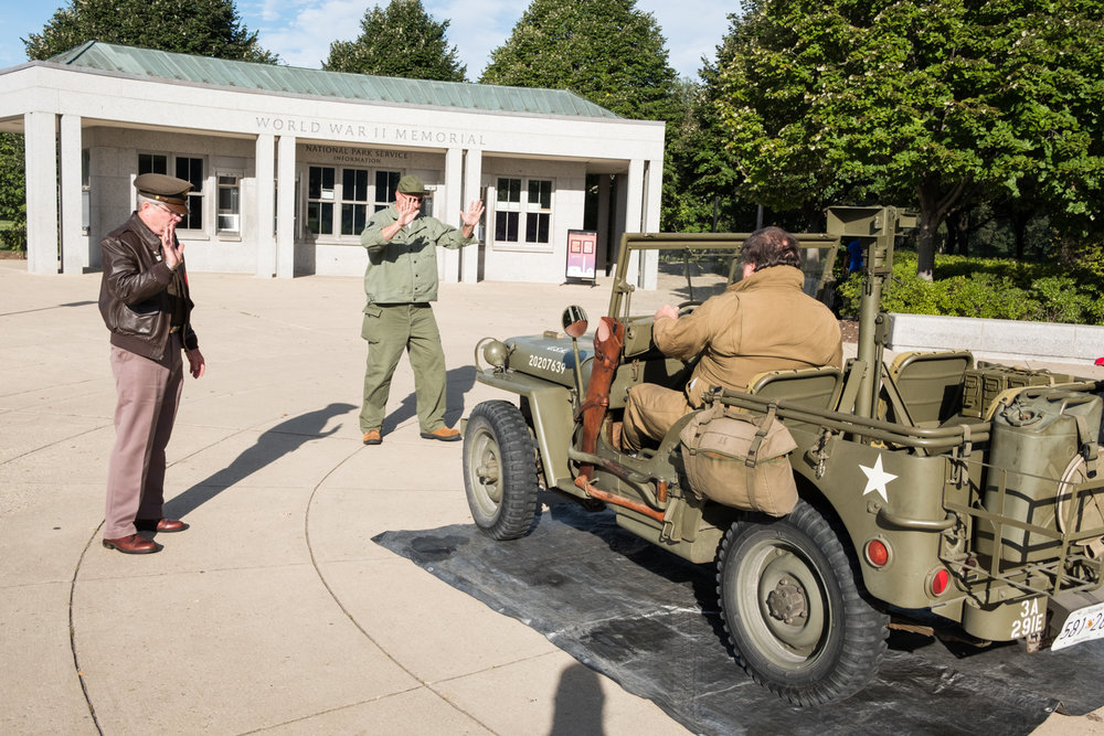Will Snyder, a war re-enactor with the Allied Airmen's Preservation Society, parks a US Army jeep near the World War II Memorial in Washington, D.C. during an Honor Flight event. Honor Flight is when veterans from around America visit the memorials on The National Mall.