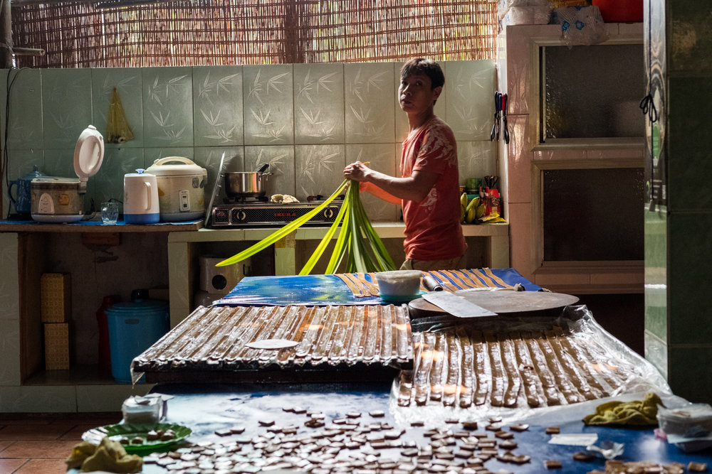 In Cai Be, a man prepare ingredients to make candies from palm sugar.