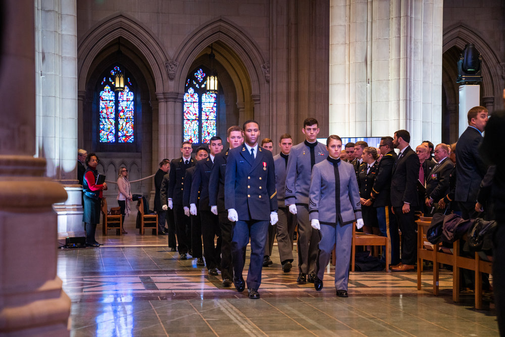 Members of the Corps of Cadets, United States Military Academy, and Members of the Brigade of Midshipmen, United States Naval Academy, prepare for the presentation of the centennial wreath.