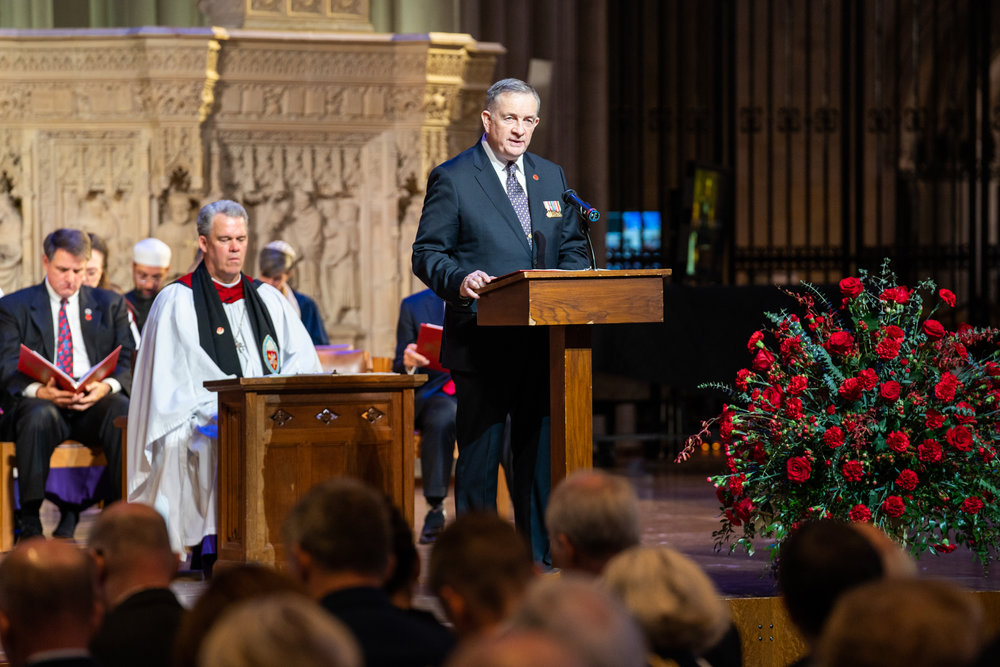 John D. Monahan, Commissioner and American Legion Representative, WWI Centennial Commission, reads a poem during the service.