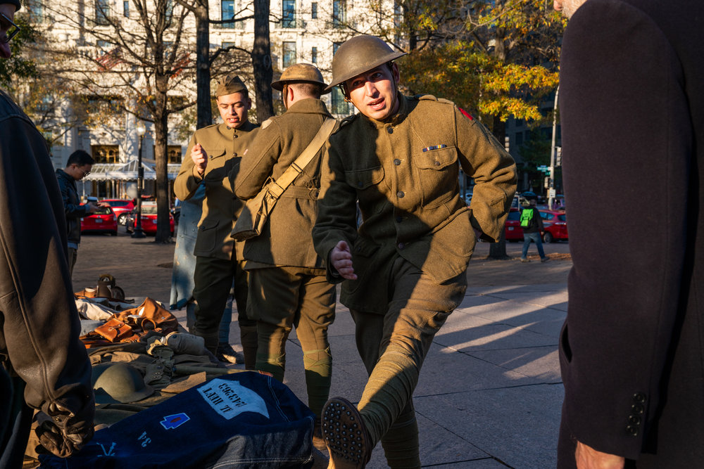 World War I American troop re-enactors explain the uniforms and gear and to attendees in Pershing Park.