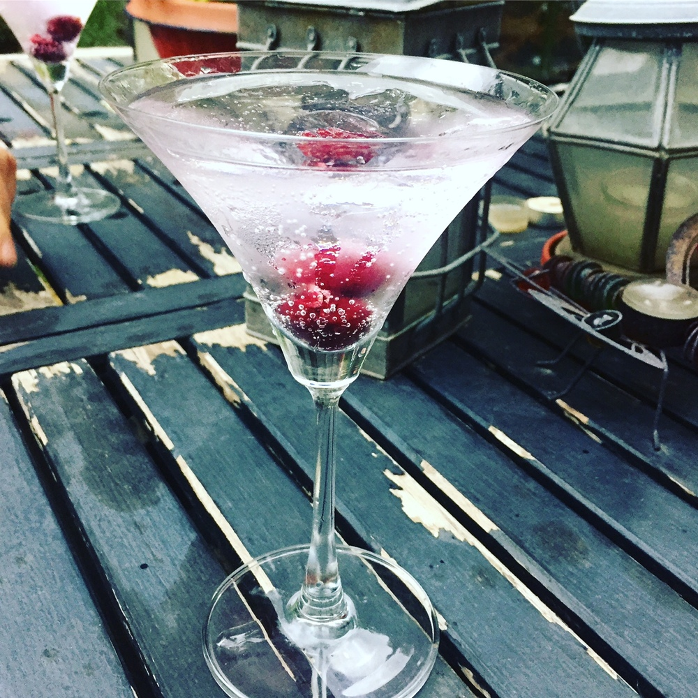 Indulging in raspberry martinis on a warm summer day