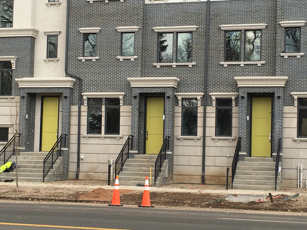 Expressive door colors on new row house project