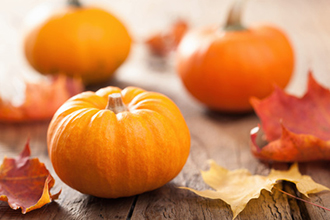 autumn halloween pumpkins on wooden background
