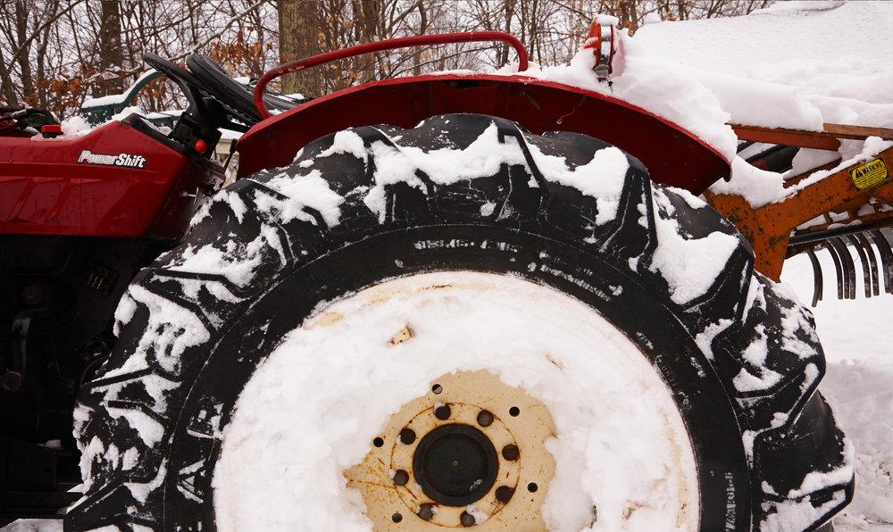 TRACTOR-WHEEL-IN-SNOW-AT-WILTSHIRE-FARM-©-JONATHAN-R.-BECKERMAN-PHOTOGRAPHY.jpg