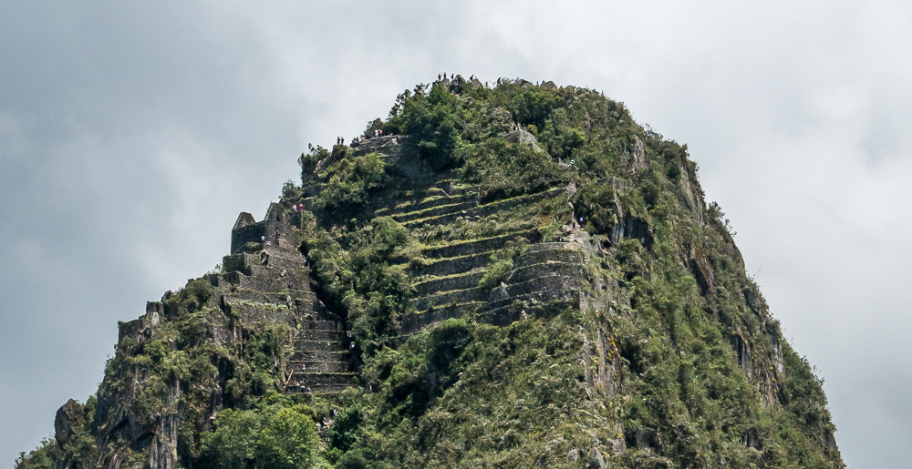 In this close up of the top of Haynu Picchu, you can see the last terraces toward the end of the climb and climbers making their way up. If you look closely at the very top, you can see climbers standing there.