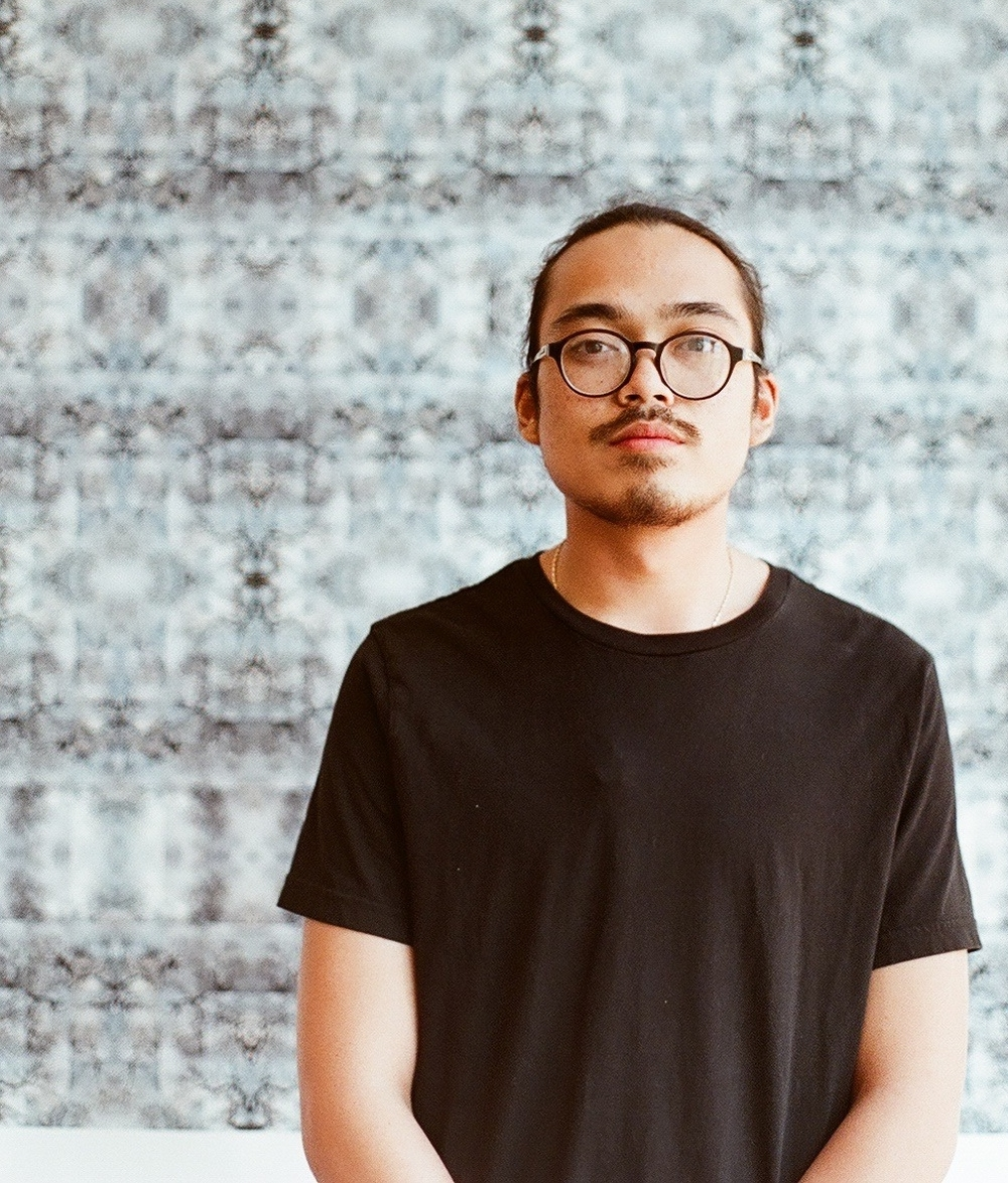 Ricky Orng   is a Cambodian-American communications designer and practicing artist. Ricky Orng is a photographer, spoken word poet, and accomplished teacher. He has worked extensively with youth organizations such as IBA, URBANO Project, and Castle Square on contemporary arts and social justice projects. He currently eats ramen at the arts community space, EMW Bookstore, and serves as the Director of Lowell's Youth Spoken Word organization, FreeVerse!. Orng hosted the first Asian American & Pacific Islander Poetry Reading at the National Poetry Slam in Boston in 2013.     He currently organizes a bi-monthly open mic in Lowell, MA. Orng has taught and facilitated many spoken word poetry workshops and readings across North America including New York City Asian American Student Conference, URBAN WORD Preemptive Education Conference, and Massachusetts Poetry Festival. His works have been featured on   Angry Asian Man  ,   Absolutely Fobulous  ,   Lowell's Artist Anthology  ,   Young Angel Midnight  ; and Cambodia's first bi-lingual fashion publication,   F-Magazine  , and   HYPEBEAST  . Orng aims to share his works and teaching in order to give tools and strength to disempowered and marginalized voices.