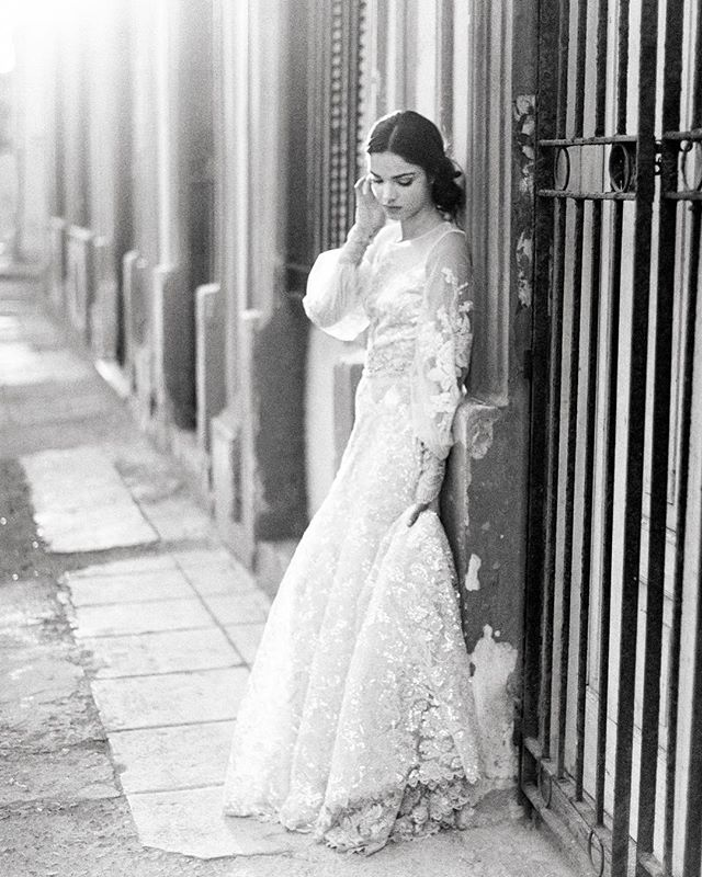 The faded Colonial glamor of La Habana, Cuba. Couldn't think of a better place to photograph this @clairepettibone gown. In Centro, Habana, the sun was setting and it was glorious. Like something out of a movie. It was a race to get some shots before that magical light was gone. And just like that it was. Model @heather.hockley. HAMU @emilyvphung. • • • • • #bride #contax645 #weddingdress #weddingday #bridal #weddingphotography #bridetobe #weddinginspiration #weddingphotographer #weddings #instawedding #blackandwhitefilm  #engaged #weddingideas #noiva #bridesmaids #weddinggown #engagement #marriage #theknot #weddingplanner #bridesmaid #ido #blackandwhitephotography #weddinginspo #weddingplanning #instabride #brides #blackandwhite #weddingphoto