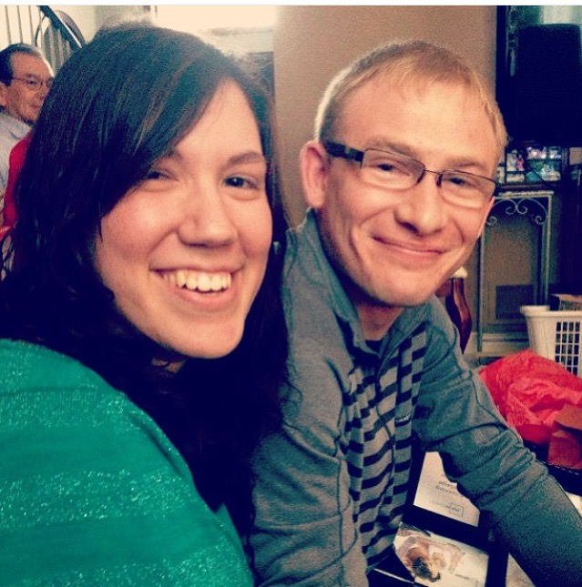 Our first picture together, taken at the aforementioned Christmas celebration. We look like babies.