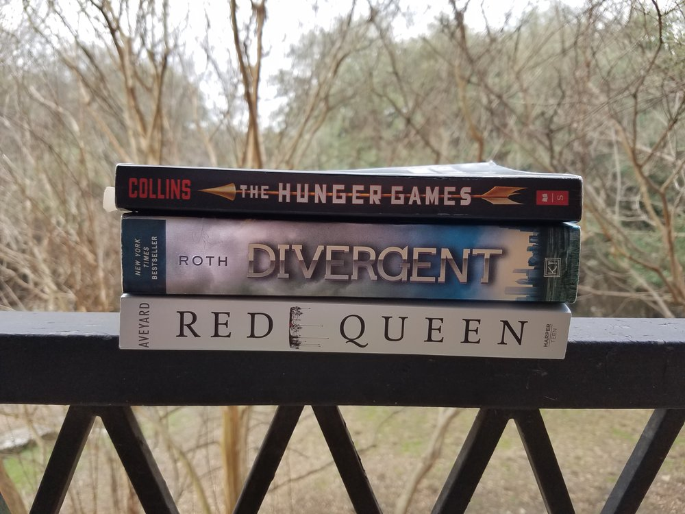 Three examples of first books in trilogies or series of dystopian YA.