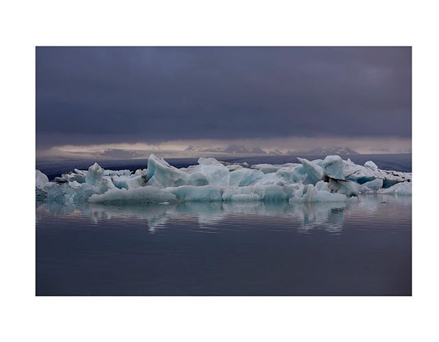 As I prepare for another project, I just wanted to share some formative photos that I have not yet posted. Jökulsárlón lagoon in Iceland was one of my first photo projects. In 2014, I took this photo when I visited Jökulsárlón for the first time and discovered that the unique, dream-like and surreal light of northern landscapes expressed what I was trying to capture in my photos. I have sought out this light ever since, although it is elusive. I have been to Jökulsárlón about a dozen times (sometimes on the same trips) since, but I have never seen the light like this. I think the larger Vatnajökull, or glacier, can be seen in the far background. The bergy bit here is from the Breiðamerkurjökull, which is part of the larger glacier. . . . #Jökulsárlón #Vatnajökull #Iceland #mystopover #icelandic #glacier #designseeds #bergybit #pastel  #thinkveryl #daydreaming #independentmagazine #canon5dmarkiii #canonphotography #solarcollective #myfeatureshoot #minimablu #minimalmag #minimalmood #imaginarymagnitude #ifyouleave