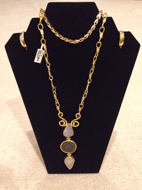 Gold Jewelry Collection - A gold necklace, bracelet and hoop earrings are all part of this collection.