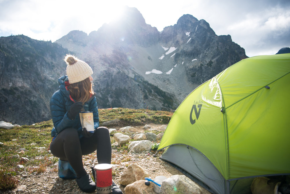 Holly (@missholldoll) at camp below Fisher Peak.