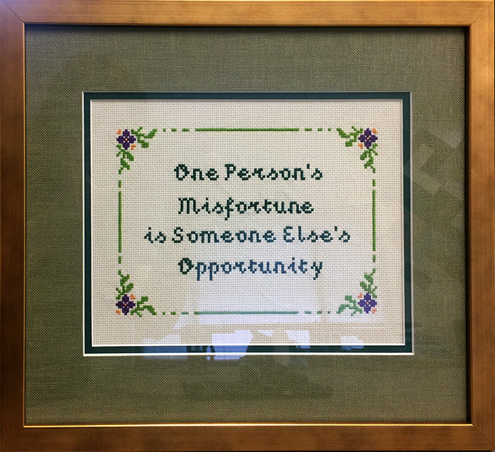 Cross-stitch quote. Quote by Donald Trump from the Real Estate Goldmine seminar. Cross-stitch by Melissa Estro. Framing by Kat Starcher.