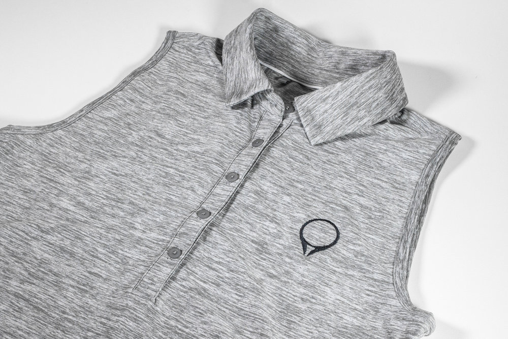 Ladies GolfStatus polo by Under Armour  Grey  |  $60